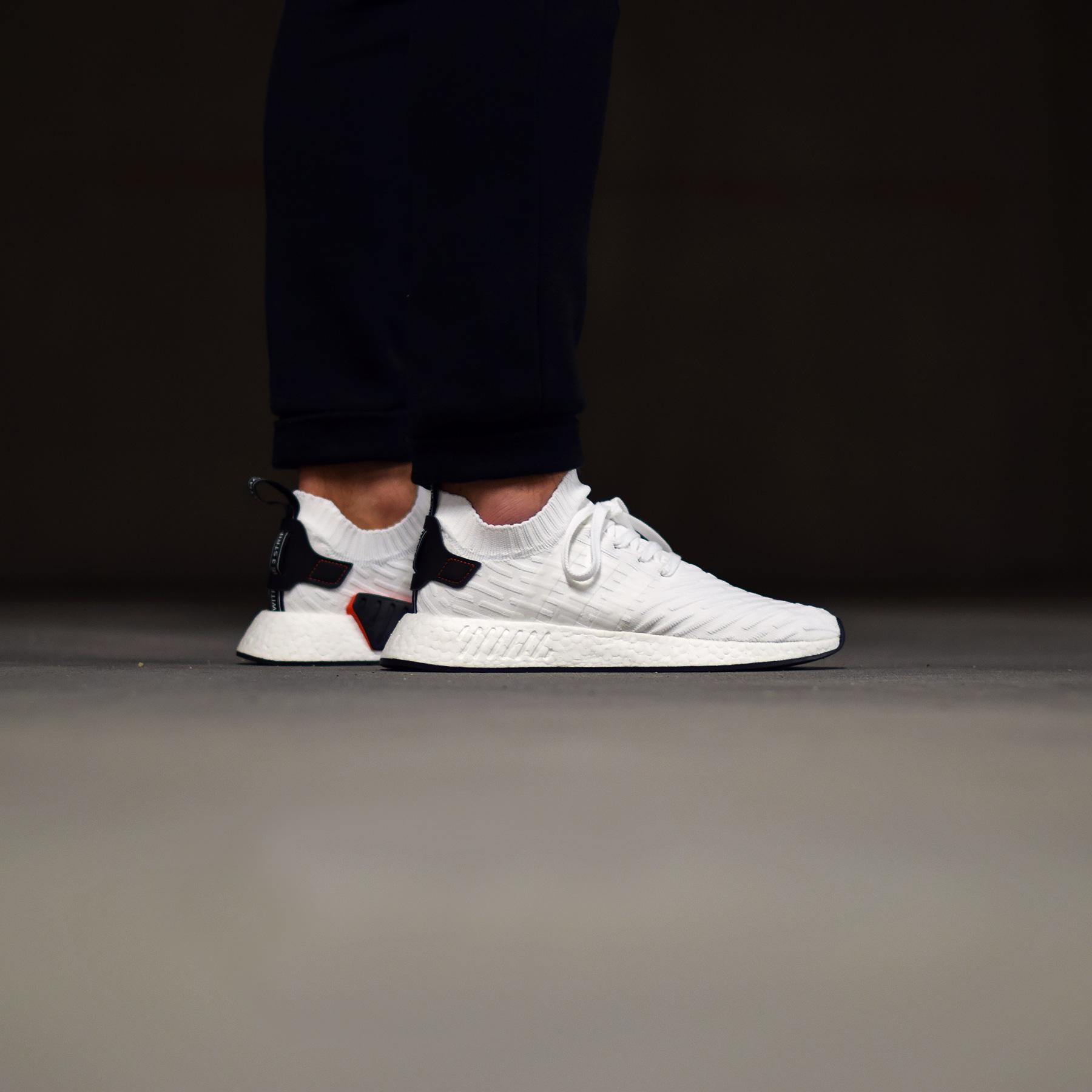 pretty nice f8e7b 9f418 adidas NMD R2 PK - White/Black/Red - Sneakers.fr